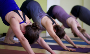 downward-dog-pose-at-yoga-class-divine-wellbeing-wagga